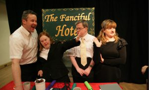 "The cast of ""The Fanciful"" hotel in character and posing for the photograph."