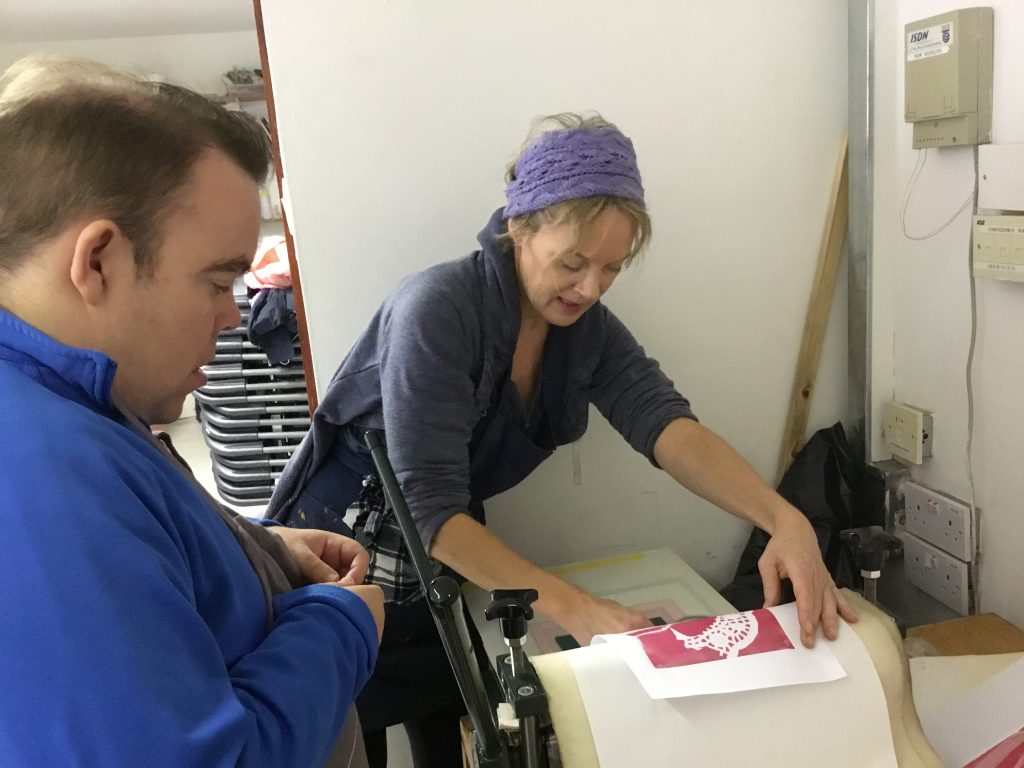 Clare revealing a print to a participant